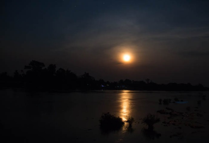 Moonrise over the Mekong. Taken from our bungalow's terrace.