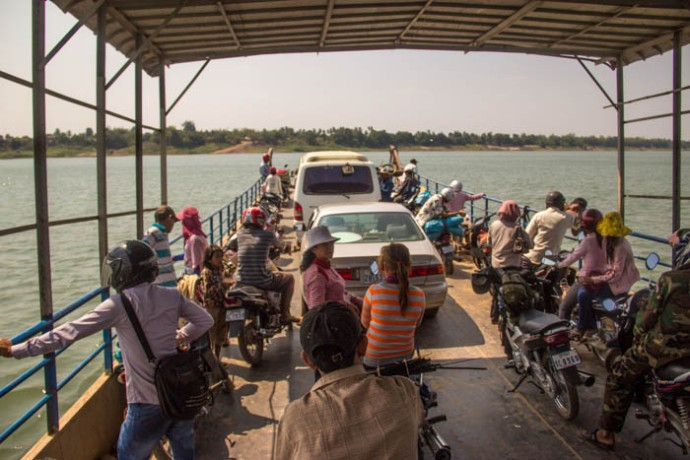Taking the Mekong Ferry South of Kratie to the other side.