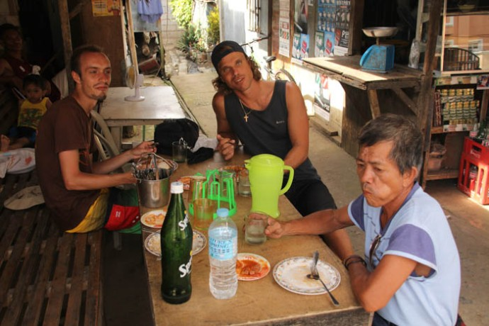 Having lunch together with our tricycle driver.