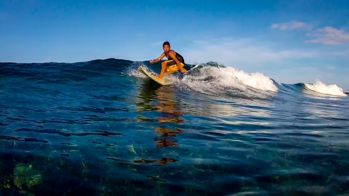 Local grom Wawa slicing a wave over the shallow reef.