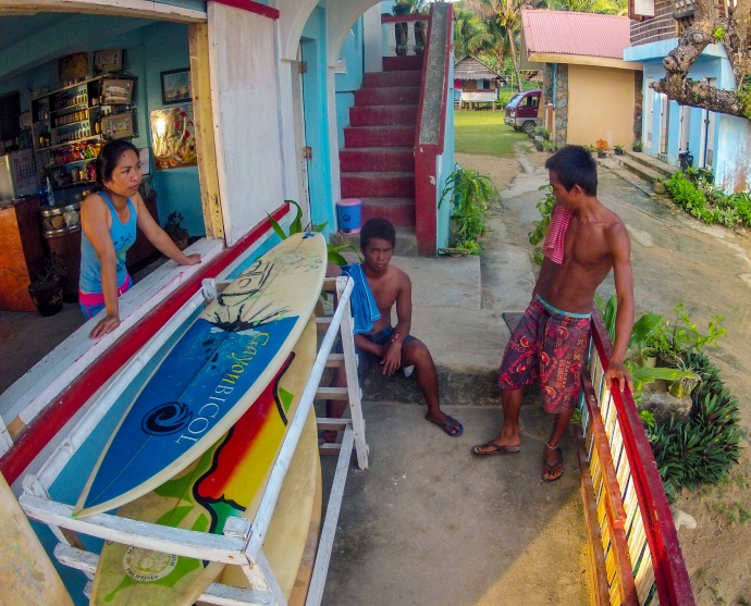 Aireen, the owner of Majestics Beach Resort, talking to local surfers.