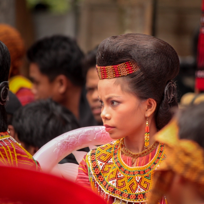 Family member dressed in traditional attire.