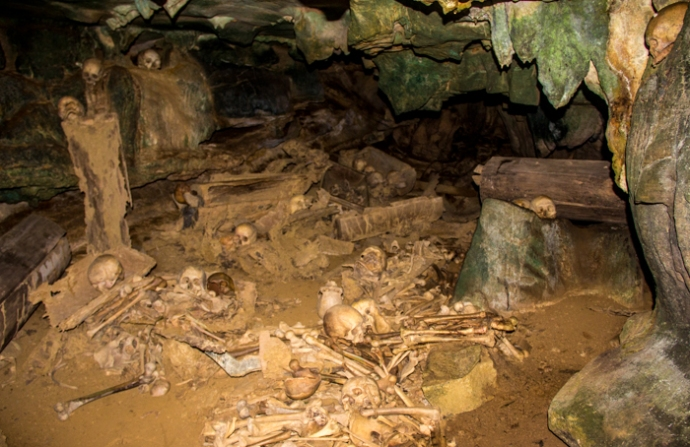 Skulls and bones in the cave.