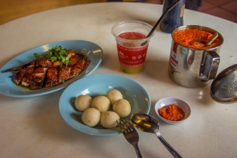 Rice balls with duck and sour plum juice. Huge sambal container on the right.