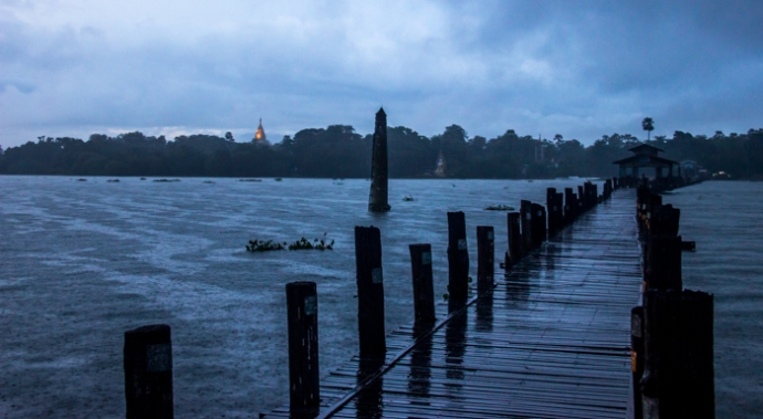 U Bein Bridge on a dark and cloudy evening.