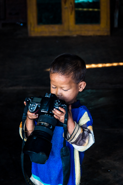 Little boy and such a huge camera.