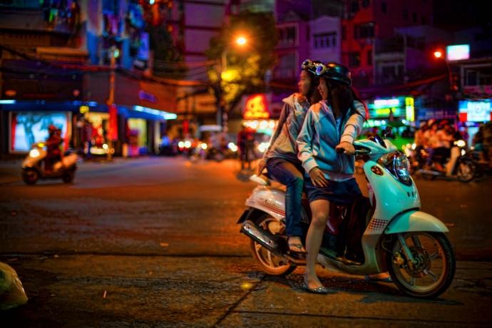 Vietnam Ladies on a scooter in Saigon, Vietnam
