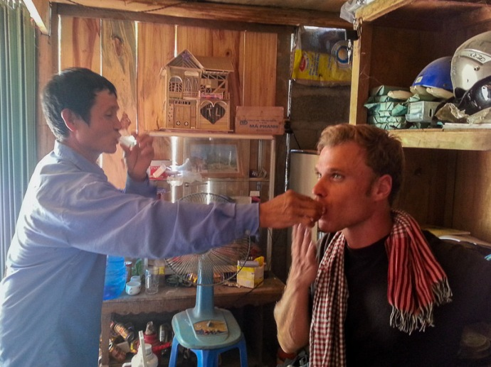 A local road stop for lunch. The locals invited me for a few shots of rice wine. One of these experiences ... (Vitenam)